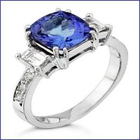 platinum ring with diamonds and sapphire center